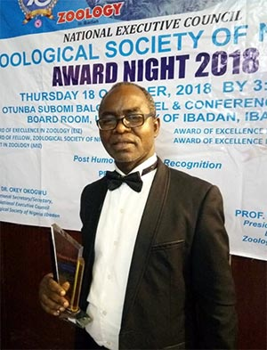Prof. A.O. Lawal Displaying the Plaque