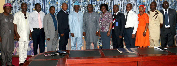 The Vice-Chancellor, Prof. Ganiyu Olatunji Olatunde (Centre in cap) in a group photograph with Prof. Abiodun Salami and other University functionaries.
