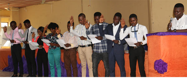 The Students' Union President, Akinbo Afolabi (Right), administering the oath of office to the other Executive members of the Students Senate