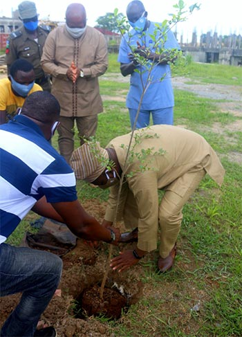 Right: The Vice-Chancellor, Prof. G.O. Olatunde Planting a Tree